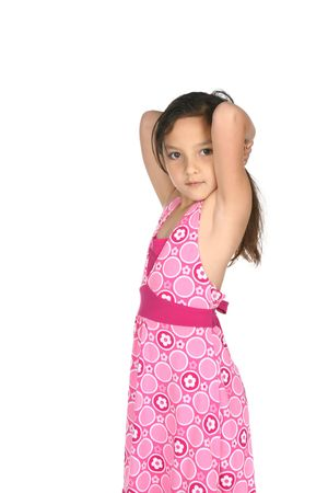 pretty girl with arms up wearing a pink sundress photo