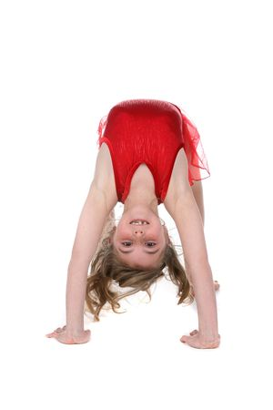 upside: athletic girl bent in gymnast or dance position Stock Photo