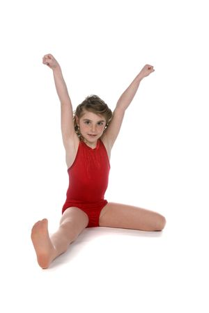 high key girl in red doing a split with raised arms