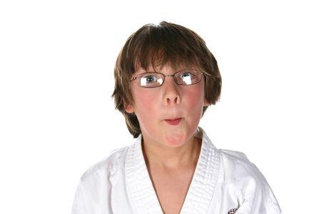 Ragazzo divertente faccia superiore di arti marziali gi e bicchieri Archivio Fotografico - 7756488