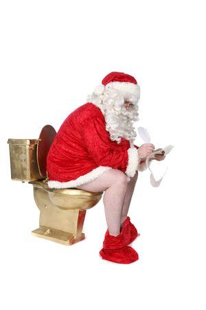 サンタ彼のクリスマスのリストを書く黄金のトイレに座っています。