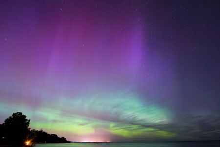 Northern Lights, Aurora Borealis displaying over Lake Michigan.