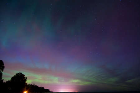 ionosphere: Northern Lights, Aurora Borealis displaying over Lake Michigan.