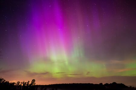 aurora borealis: Northern Lights, Aurora Borealis displaying over a lake in Wisconsin. Stock Photo