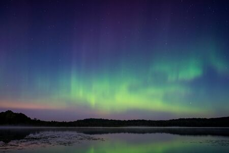 northern lights: The northern lights, aurora borealis over a lake in Wisconsin. Stock Photo