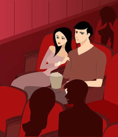 differential focus: A couple at the theatre watching a movie Stock Photo