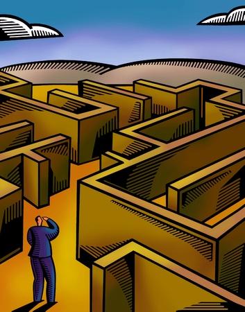 A businessman walking through a maze Stock Photo