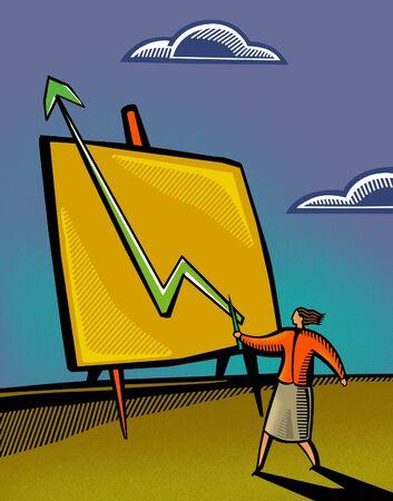 Una donna d'affari che punta a un grafico di vendita Archivio Fotografico - 14887924