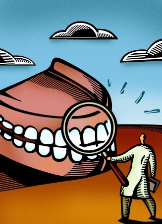 Dentist looking at giant dentures through a magnifier Standard-Bild
