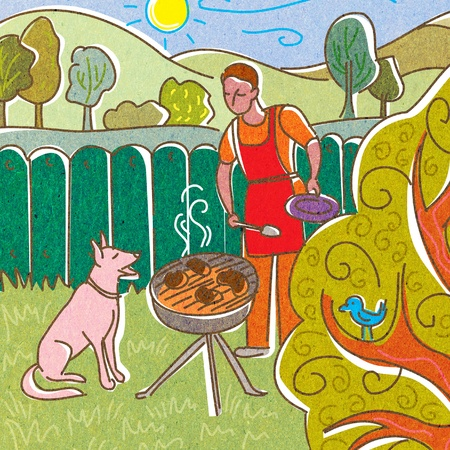 barbecuing: A man barbecuing in his backyard with his dog Stock Photo