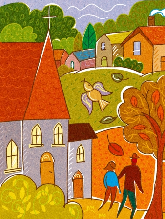 A couple walking past a church with a town in the background