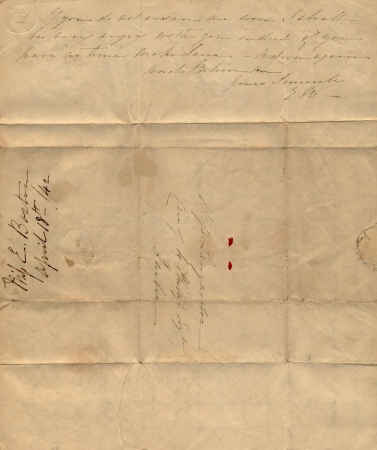 An old letter with fold marks and faded handwriting Stock Photo