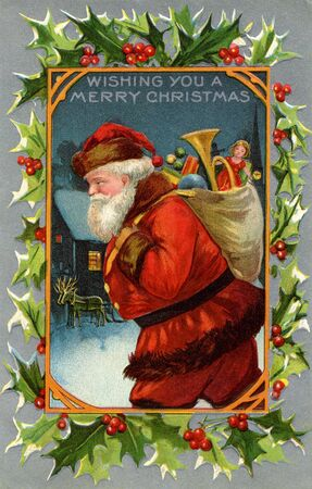 Vintage Christmas card of Santa Claus and a sack full of gifts photo