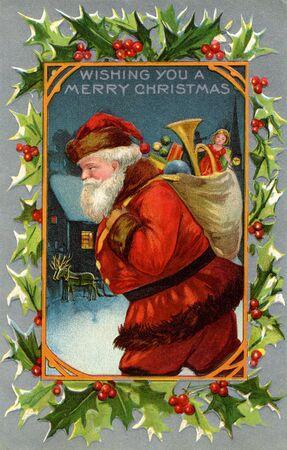 Vintage Kerstkaart van de kerstman en een zak vol geschenken Stockfoto