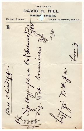 western script: A vintage handwritten medical prescription