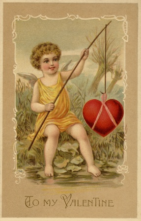 A vintage Valentines Day card with a cupid fishing a heart photo