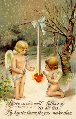A vintage Valentine card with two cherubs warming up next to a heart on fire Stok Fotoğraf