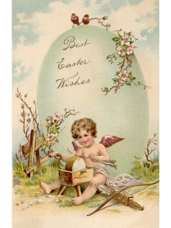 A vintage Easter postcard of a cupid making arrows and a large Easter egg Banque d'images
