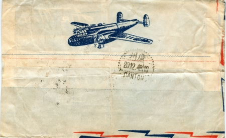 old fashioned: vintage airmail envelope with a plane on it Stock Photo
