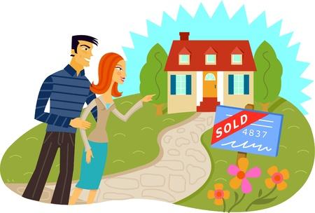 Een man en een vrouw in de voorkant van een huis met een verkocht bord
