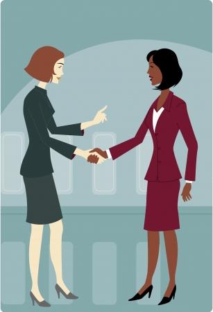 studio zoo: Two businesswomen shaking hands