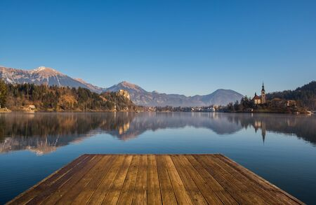 A wooden dock, pier, on a lake in autumn
