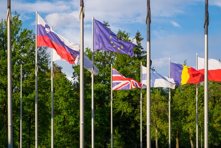 british people: Flags of the United Kingdom and the European Union between flags of other EU members. British people voting about EU membership on referendum. Brexit, United Kingdom withdrawal from the European Union