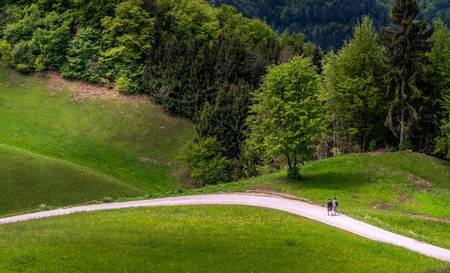 Landscape with family walking in the hills Archivio Fotografico