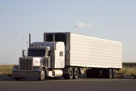 A tractor-trailer truck in a parking lot. Stock Photo - 278538