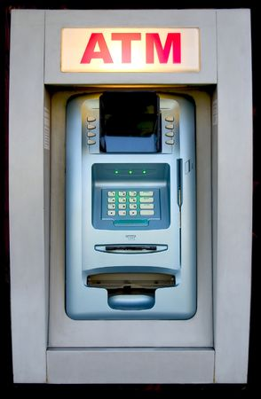 An automated teller machine is ready to provide cash. Imagens