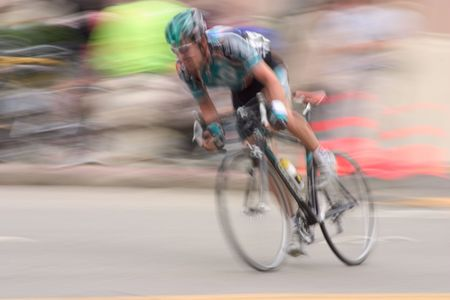An intentional slow-shutter blur, gives this bike racer feeling of motion and intensity.  It also removes all the sponsors from his jersy (And we like that).