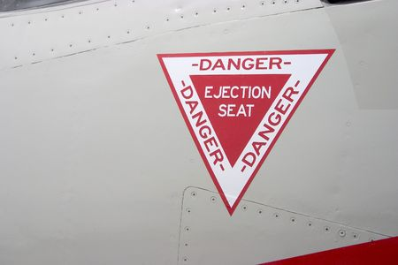 The ejection seat warning on the outside of a fighter jet.