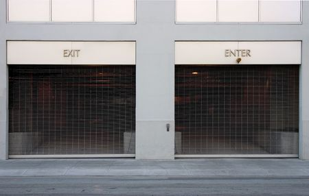 A very simple image of two car ports; one marked Exit, the other Enter.