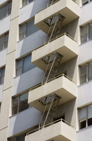 Fire escapes on the face of a highrise apartment building. Stock Photo - 280096
