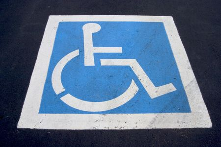The familiar handicaped icon, painted on a parking spot.