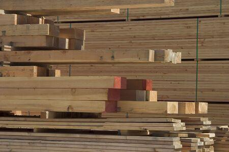 A pile of lumber at a lumberyard. Banco de Imagens