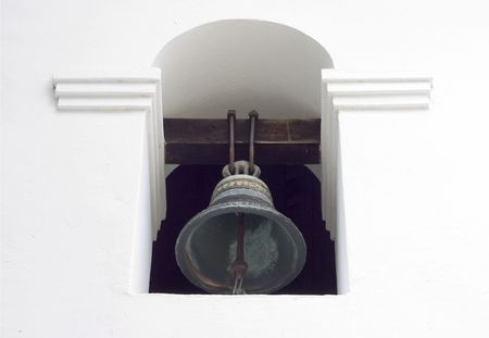 A bell on the side of San Louis Obispo mission.