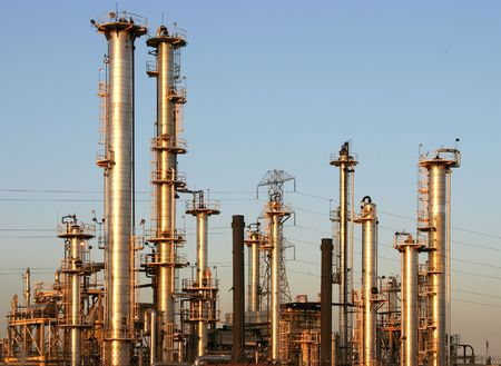 The towers and piples of an oil refinery.