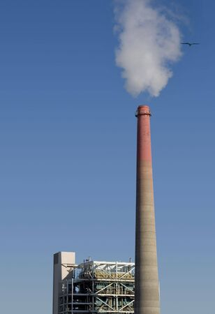 A smokestack belches pollution from a power plant.