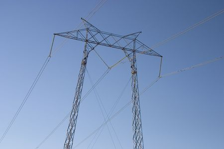 Hight voltage lines are held aloft by a giant power tower.