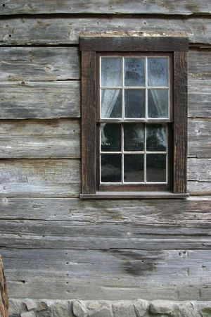 aging american: A very rustic window on an old mountain cabin. Stock Photo