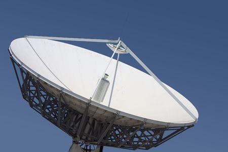 A satellite dish points skyward.