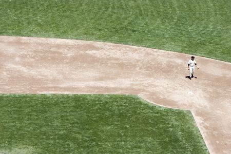 A baseball player at second base.