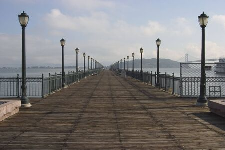extends: A pier extends into San Franciscos waterfront.  Stock Photo