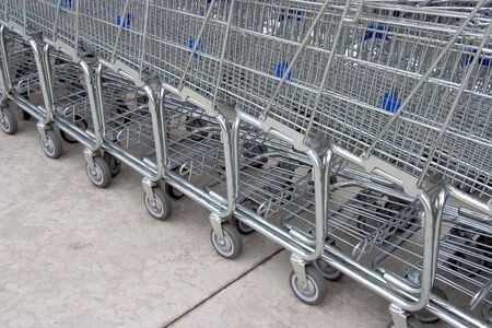 consume: A line of shopping carts nested together.