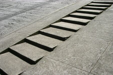 A steep San Francisco sidewalk with steps etched into the cement. Banco de Imagens