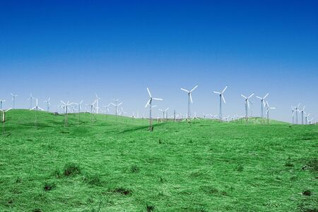 altamont pass: A group of windmills on rolling hills in California.