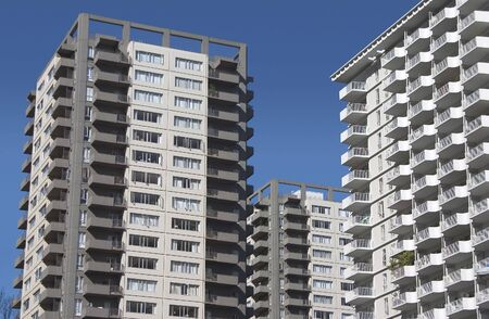 overpopulation: A cluster of modern (probably from the 60s) apartments. Stock Photo