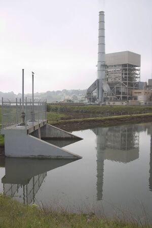 A rather glum view of a power plant. photo