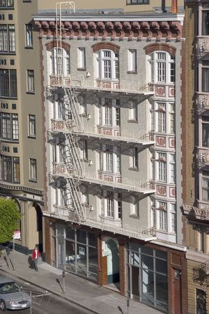 An old downtown apartment building as view from another building across the street. Stock Photo - 338470